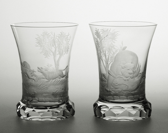 Cut and engraved glasses with hunting motives of lux and dogs